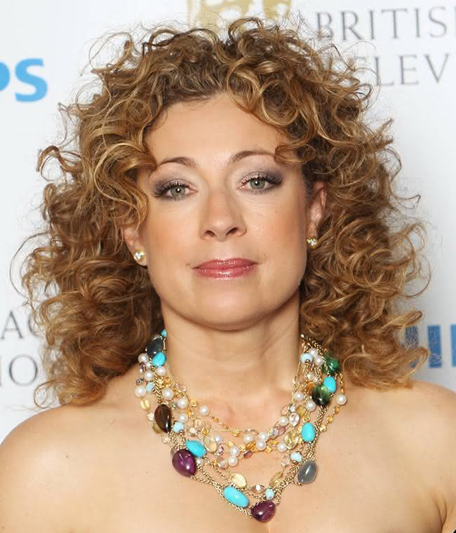 LONDON, ENGLAND - MAY 22: (UK TABLOID NEWSPAPERS OUT) Alex Kingston poses in front of the winners boards at The Phillips British Academy Awards 2011 at The Grosvenor House Hotel on May 22, 2011 in London, England. (Photo by Dave Hogan/Getty Images)